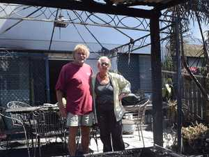 Owners return to scorched, but still standing home