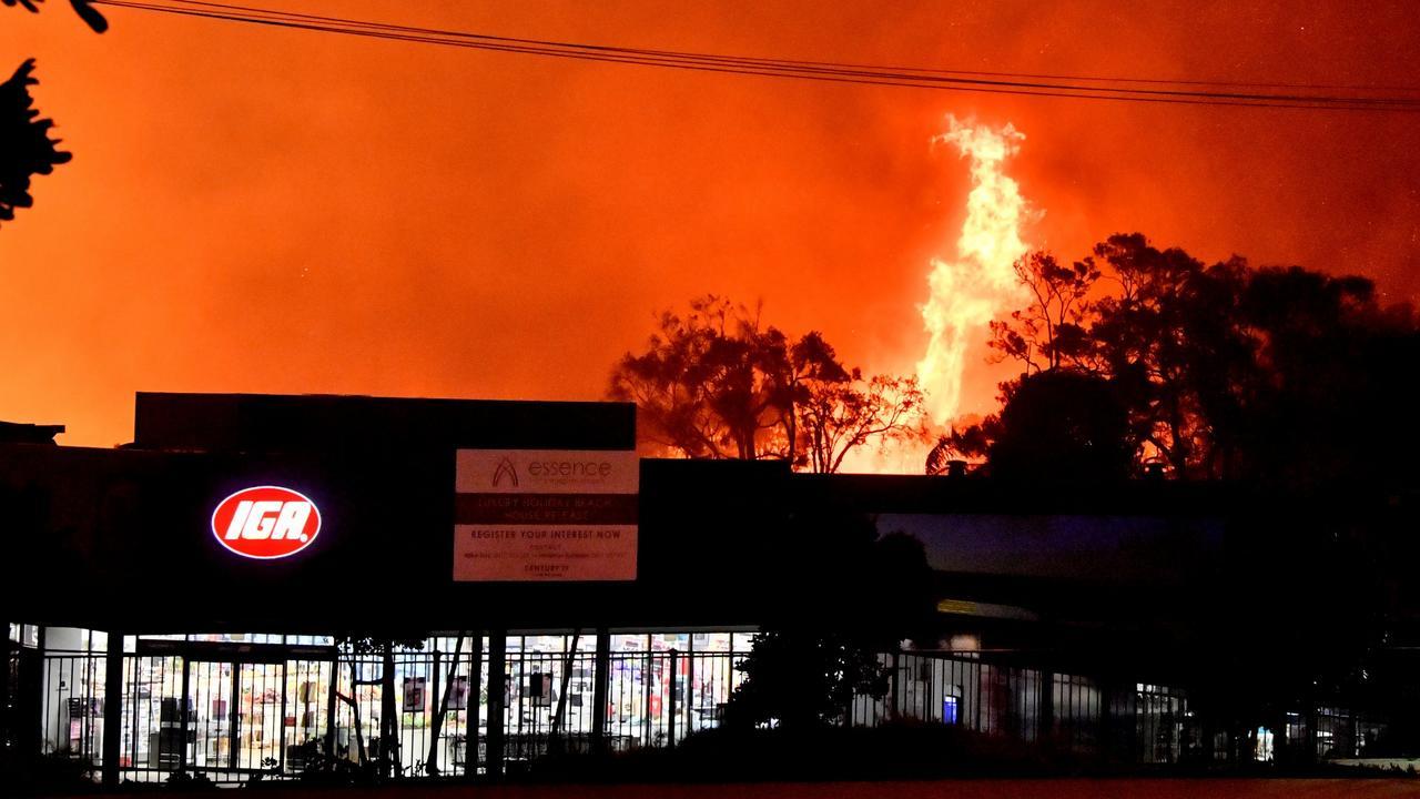 A fire burns neat Peregian Beach IGA on Monday night. Photo: John McCutcheon / Sunshine Coast Daily