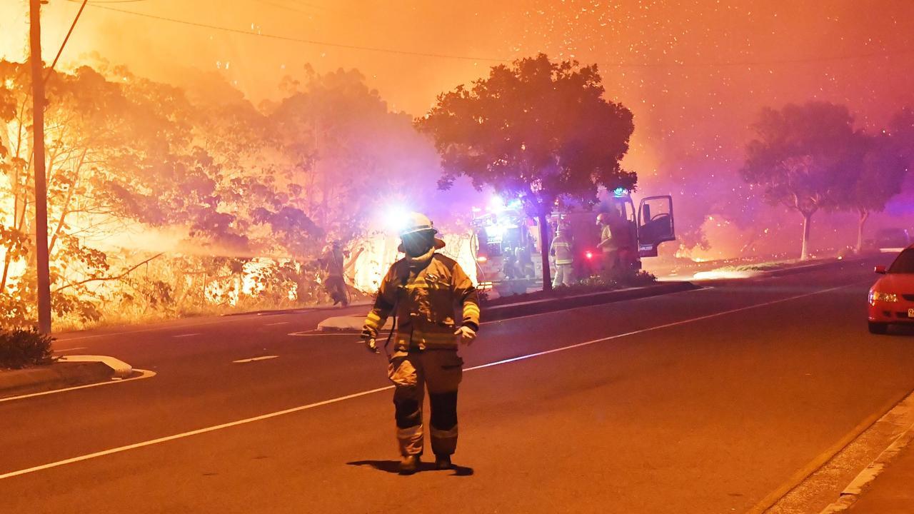 Fire crews battle a fire on David Low Way near Lorikeet Drive at Peregian Beach on Monday night. Photo Patrick Woods / Sunshine Coast Daily.