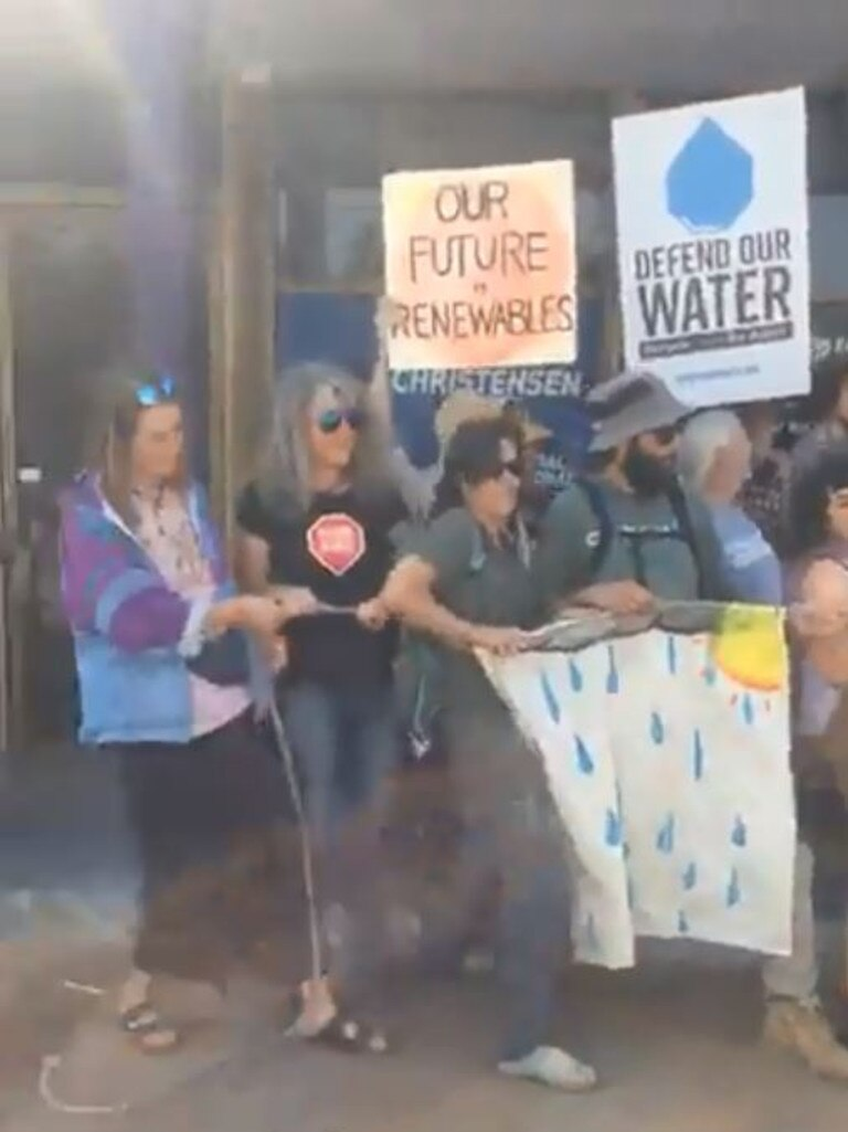 Footage shared by Frontline Action on Coal shows Swedish international student Sheridan Vautier (left) participating in a protest outside George Christensen's office.