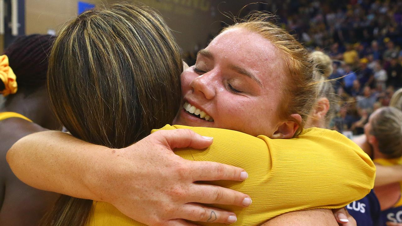 Steph Wood hugs coach Noeline Taurua after the Lightning won the major semi-final against the NSW Swifts to win hosting rights for the Super Netball grand final.