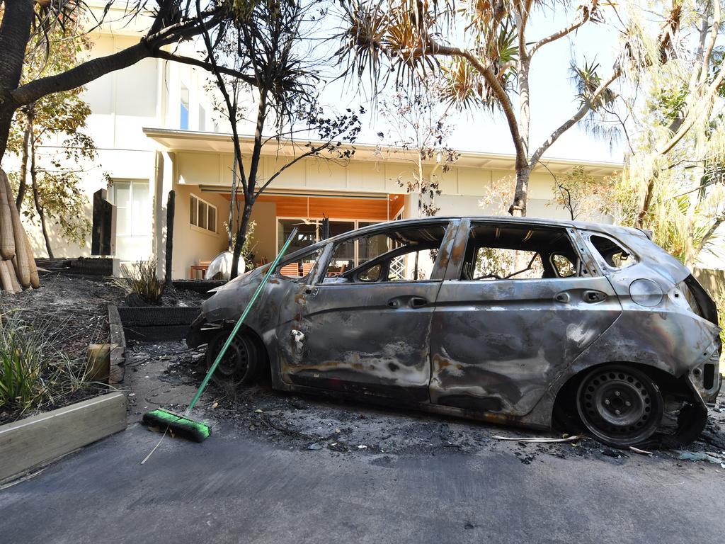 A burnt car on a street at Peregian Beach. Photo: John McCutcheon / Sunshine Coast Daily