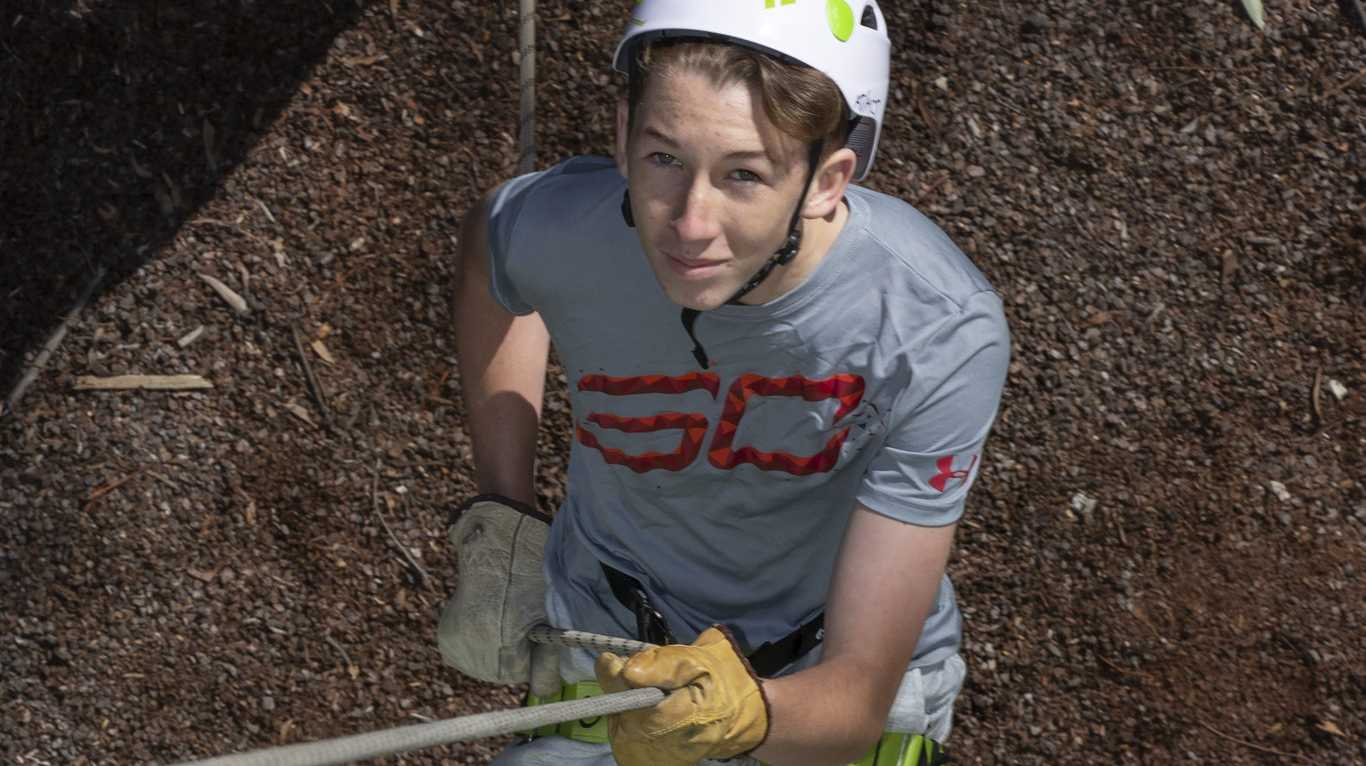 Jack Brophy descends the abseiling structure at the Australian Defence Force Academy.