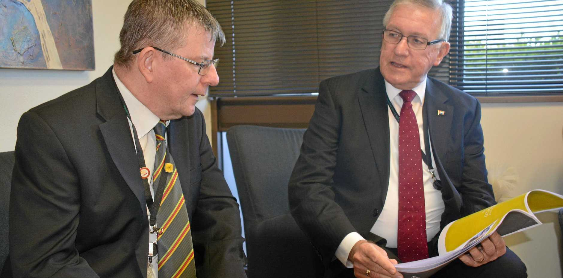 BUDGET: South Burnett Regional Council CEO Mark Pitt and Mayor Keith Campbell look over the 2019/20 budget.