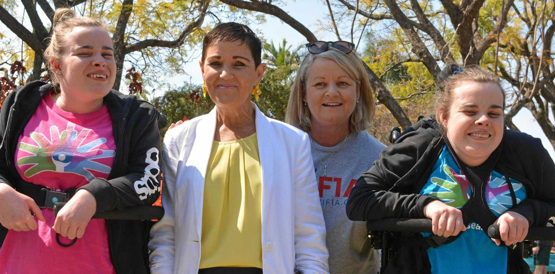 Sisters Gemma and Shaye Harrison with mother Sandra Harrison and their former support worker Mayor Tanya Milligan.