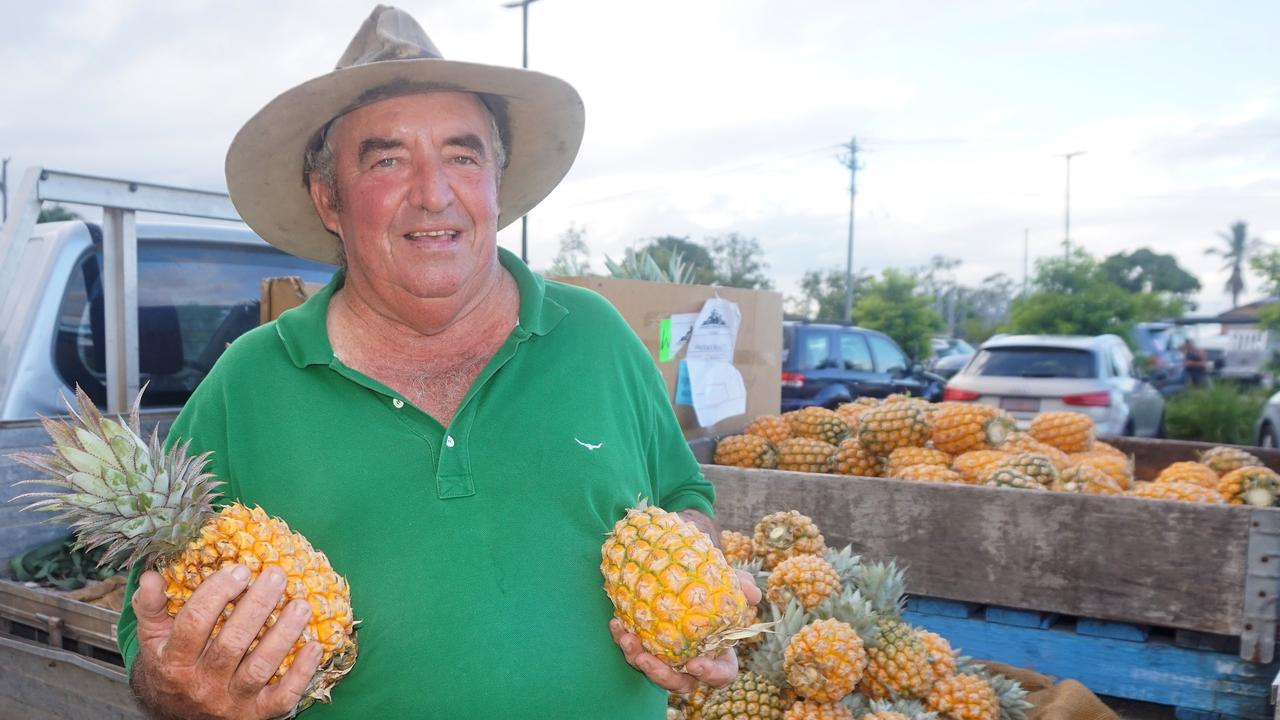 Grower John Zelenka with fresh pineapples at the Sarina Arts and Crafts twilight markets.