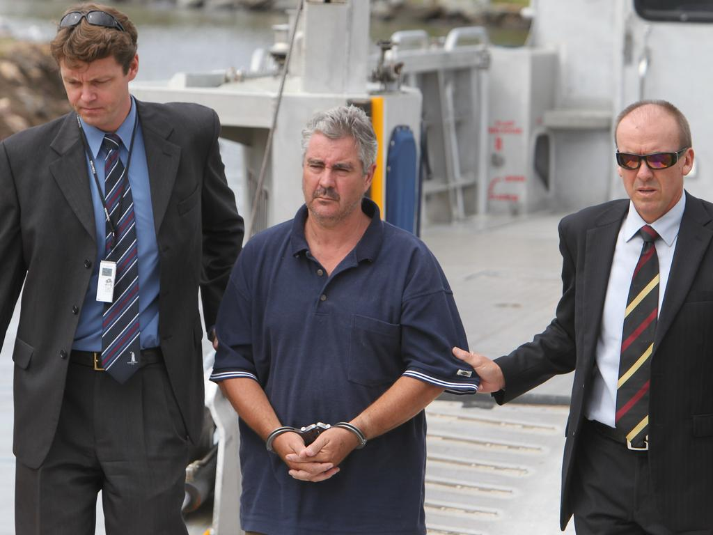 Steven Fennell in police custody at Redland Bay in 2013. Picture: Annette Dew