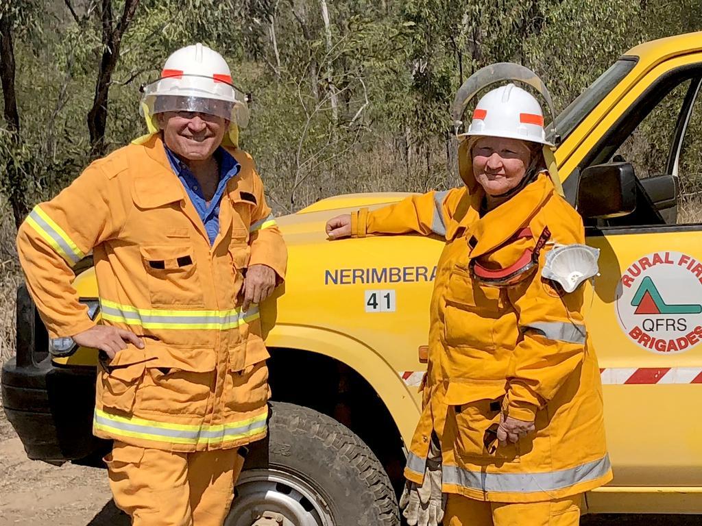 Ian McDonald and Kathleen Ellrott of the Nerimbera Rural Fire Service keep an eye out on the blazes above North Rockhampton.