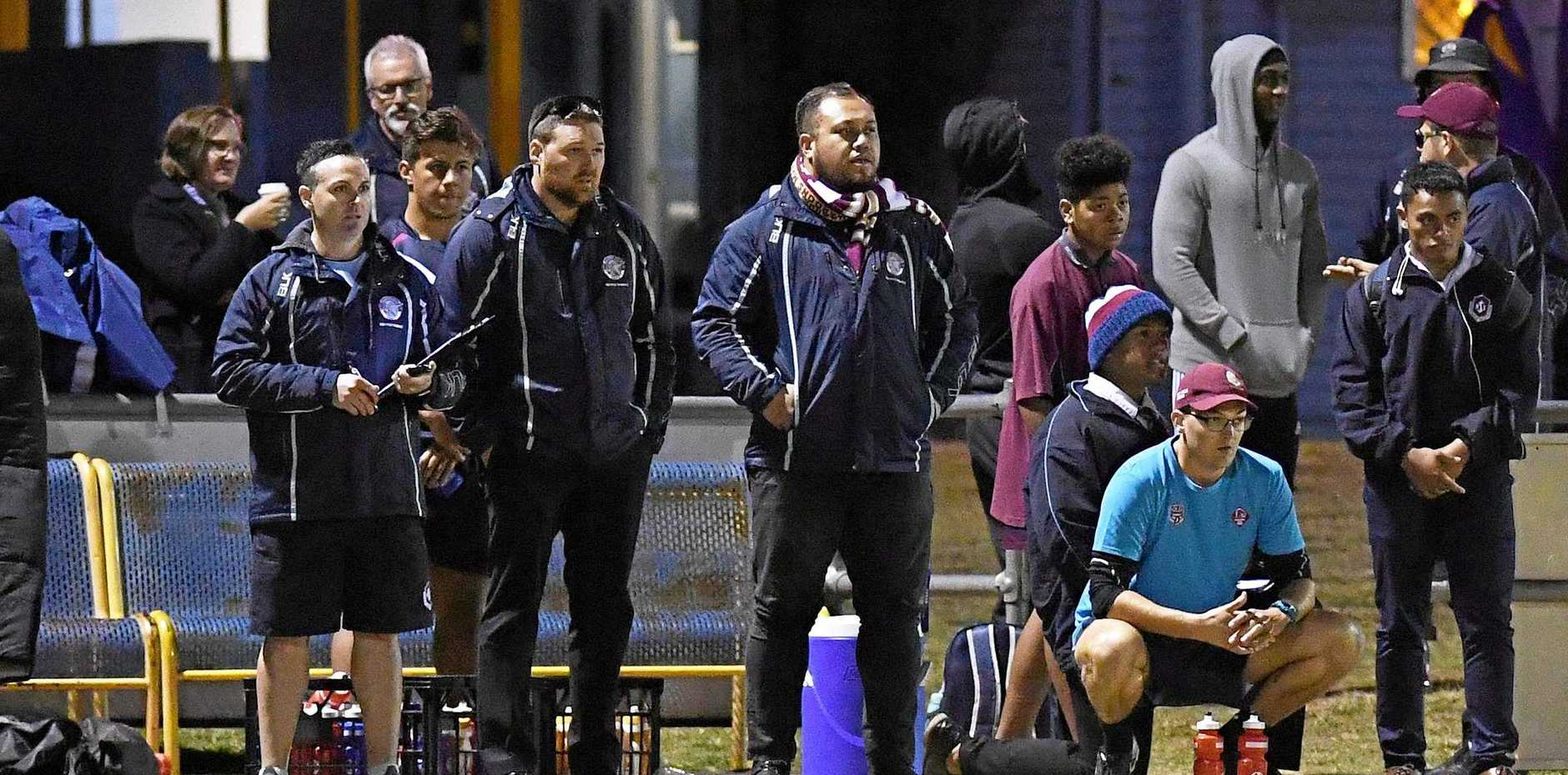 MOULDING PROFESSIONALS: Josh Bretherton and the Ipswich High School coaching team watch on during a game this season.