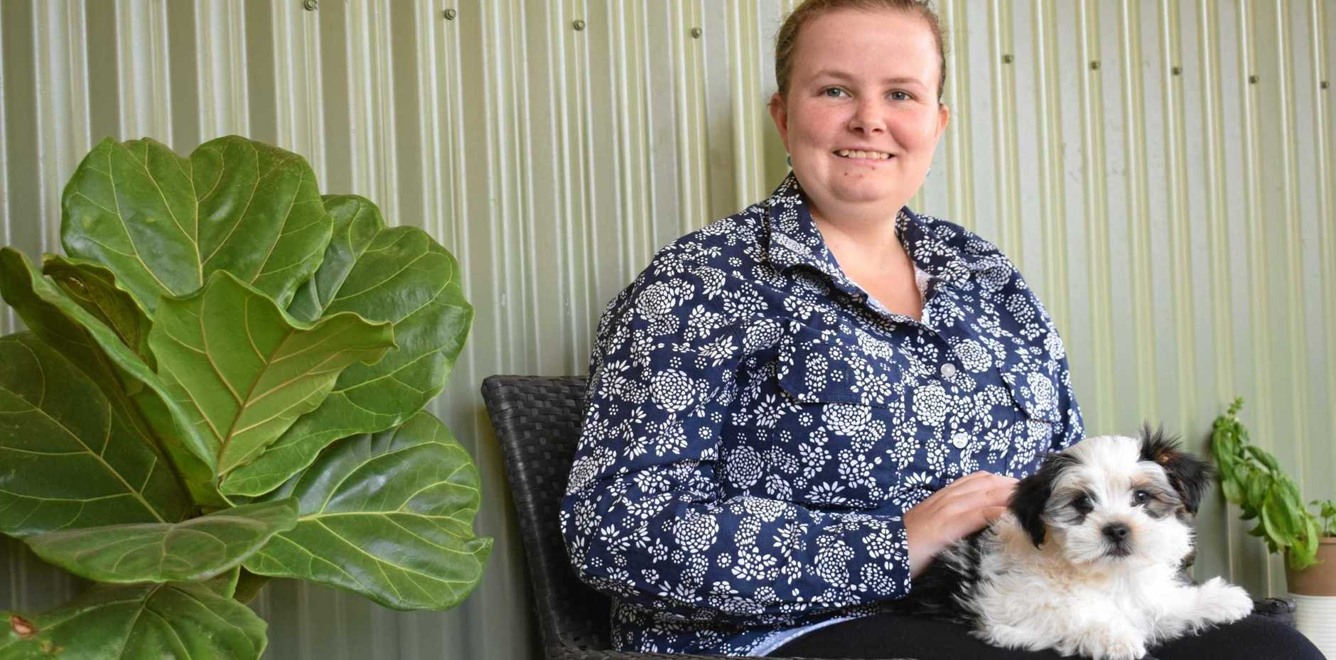 FIND A WAY: Hope Biltoft and her sweet new therapy puppy, Dexter. Hope is facing invasive surgery for brain cancer and her family is raising funds to get her a safer treatment under Charlie Teo.