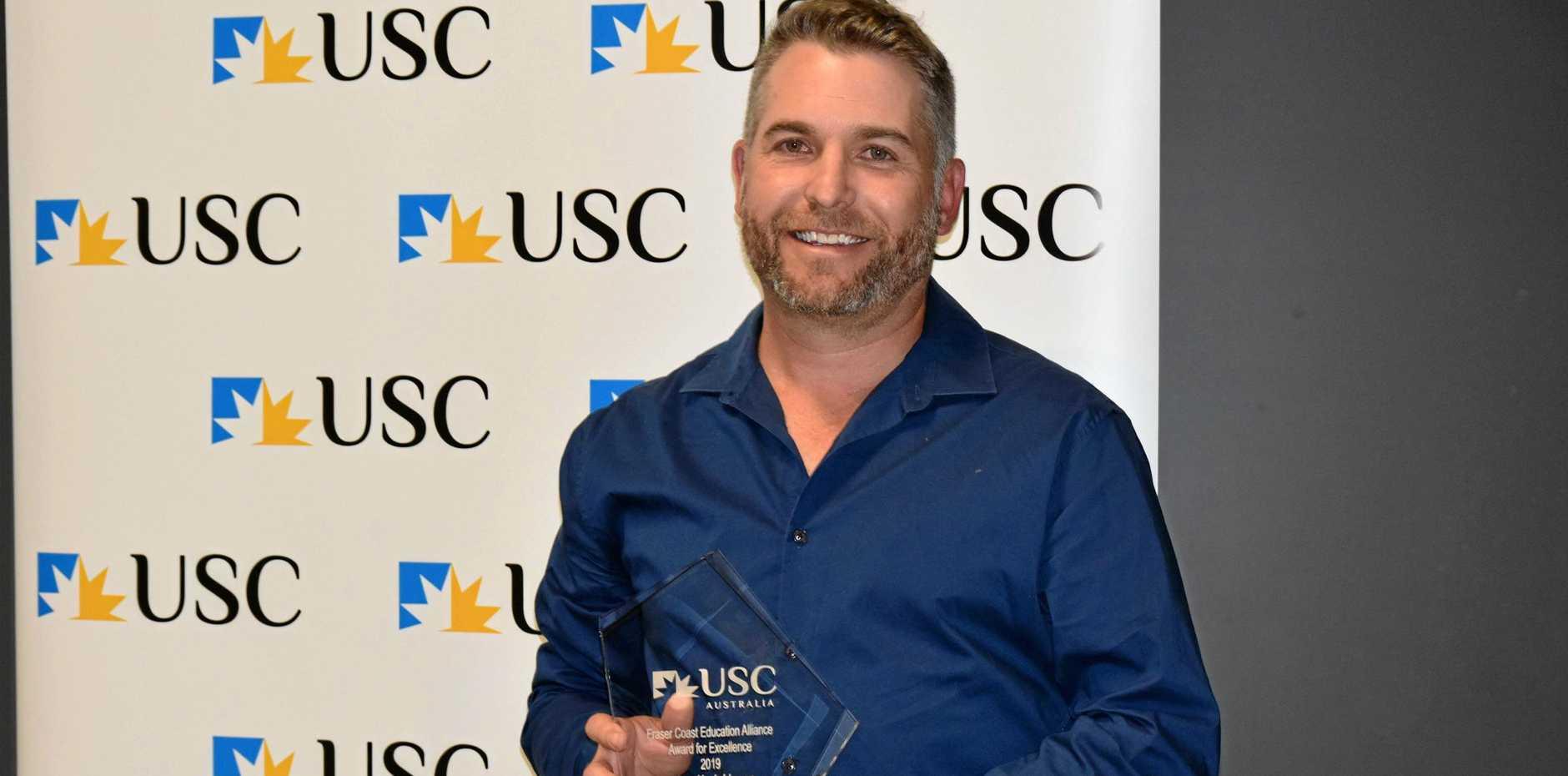 TOP EDUCATOR: Aldridge State High School music teacher Adam Hodgkinson was named USC Fraser Coast Educator of the Year at Thursday's Fraser Coast Education Alliance Annual Awards for Excellence ceremony.