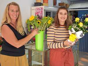 Sunflowers, yellow roses and flowers galore for new owner
