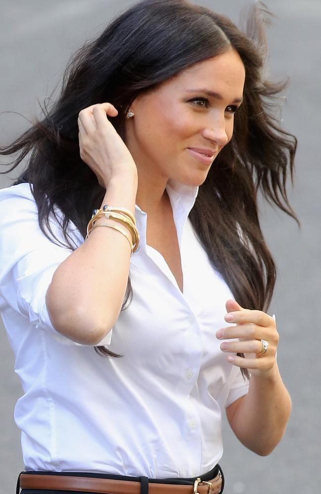 Meghan, Duchess of Sussex, wears earrings and bracelets from Princess Diana's collection for the launch. Picture: Getty