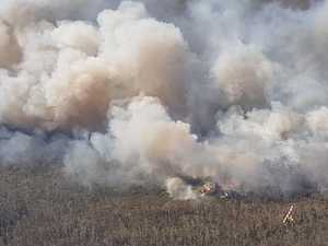 Firefighters contain reignited bushfire