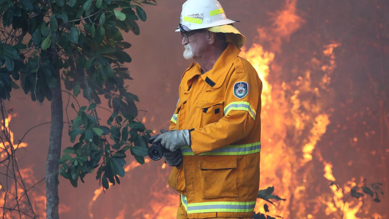 Queensland firefighters are set to be replaced as fire warnings continue. Picture AAP/Jason O'Brien