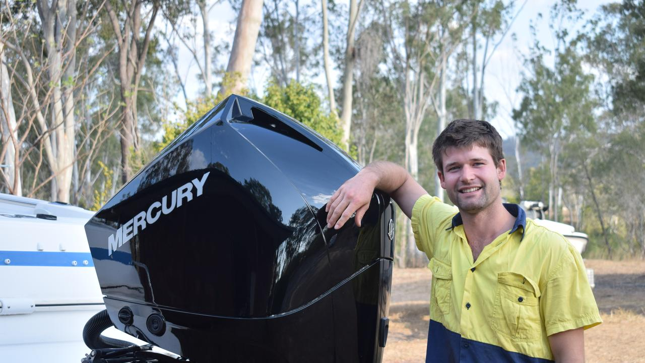 ME AND MY BOAT: Blake Williams, 23, with the latest addition to his Haines Signature 702 Sports Bridge - a 225 HP four-stroke Mercury outboard purchased from Ship and Sail Chandlery in Gladstone.