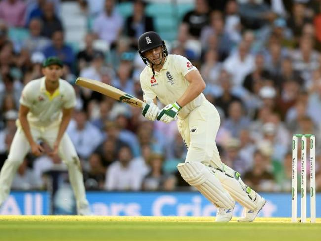 Jos Buttler dug England out of a hole late on day one with an unbeaten half century.