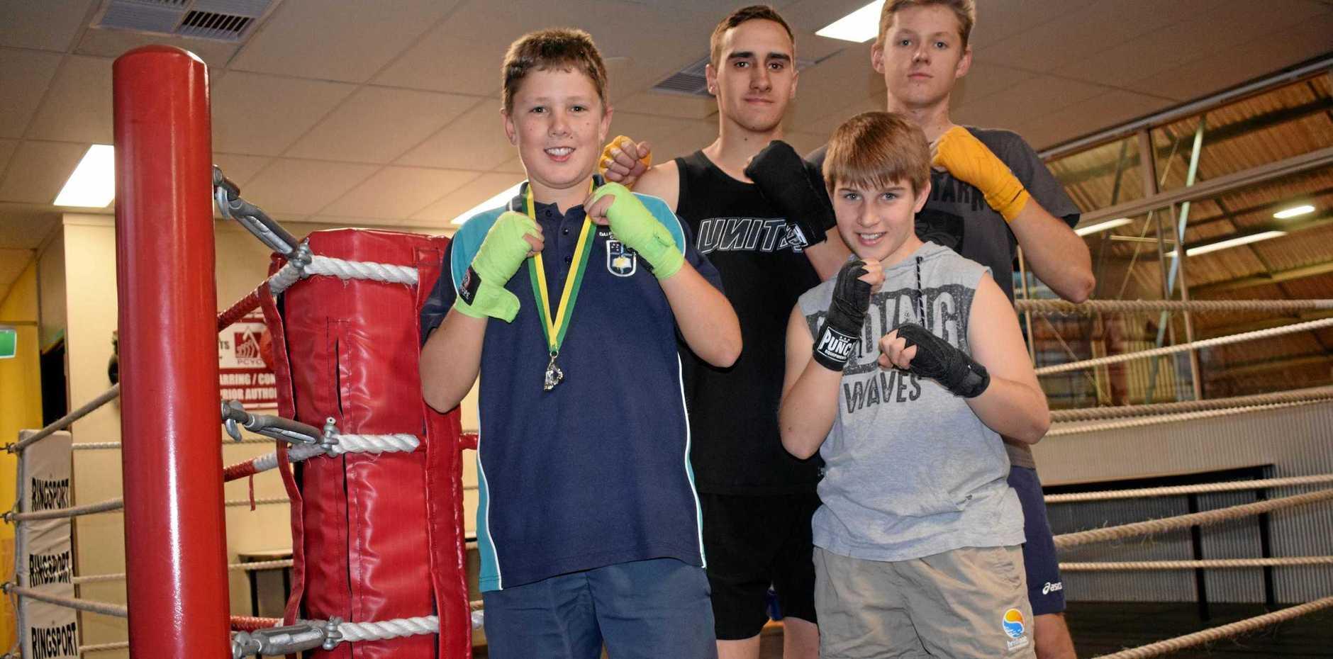 GLOVES UP: Bailey Taylor, Chase Alderton, Judd Alderton and Brandon Taylor.