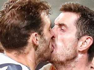 AFL stunned by amazing kiss photo