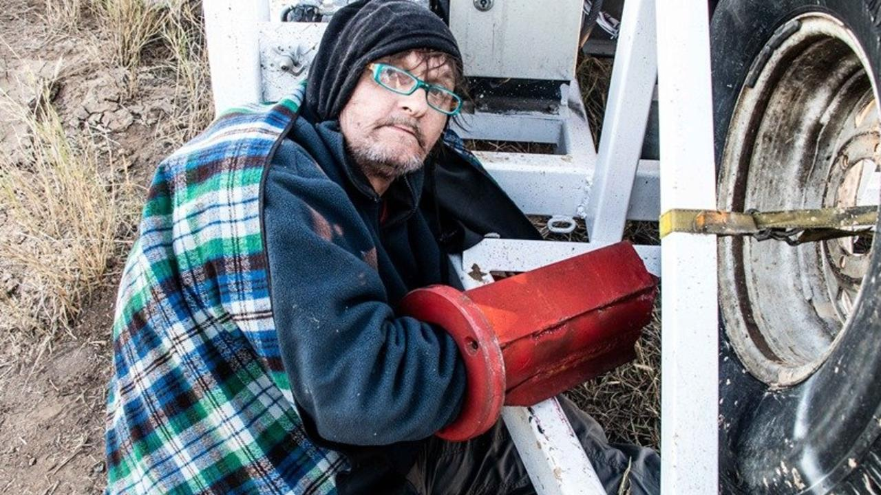 Protester John Williams locked to a drill rig at Adani's Carmichael mine site. He was not involved in the alleged assault written about in this article.