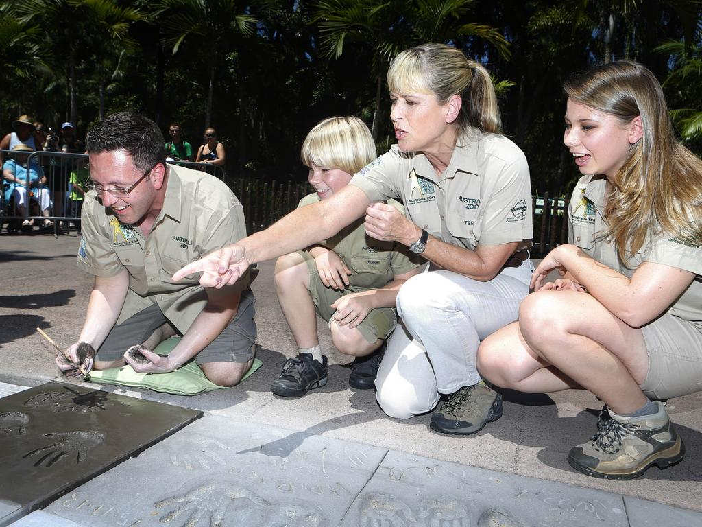 Steve irwin day Terri, Bindi and Robert Irwin y with special guest, internationally renowned psychic medium John Edwards and a wombat. Picture: Megan Slade.