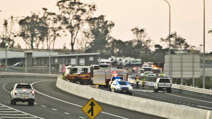 Paramedics attend the first crash on the Toowoomba Bypasss