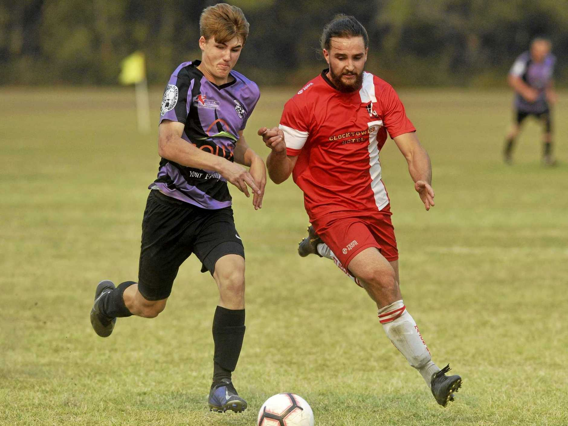 Majos' Braydan Jones takes on Grafton's Bailey Bathgate in the Men's Division 2 North grand final between Grafton United Sirens and Majos FC White at Yamba on Saturday.