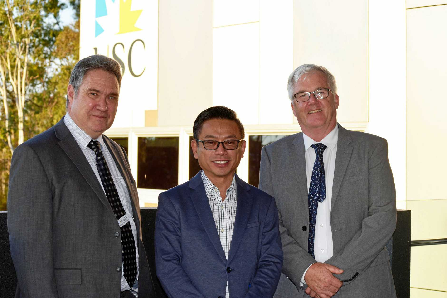 PROGRESS: Australia's Consul-General in South-West China Christopher Lim (centre) with Professor Ken Greenwood and USC Pro Vic-Chancellor Professor Tim Wess.