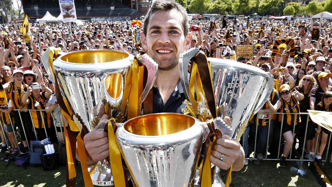 Luke Hodge with three of his four Hawthorn premiership cups. Picture: Michael Klein