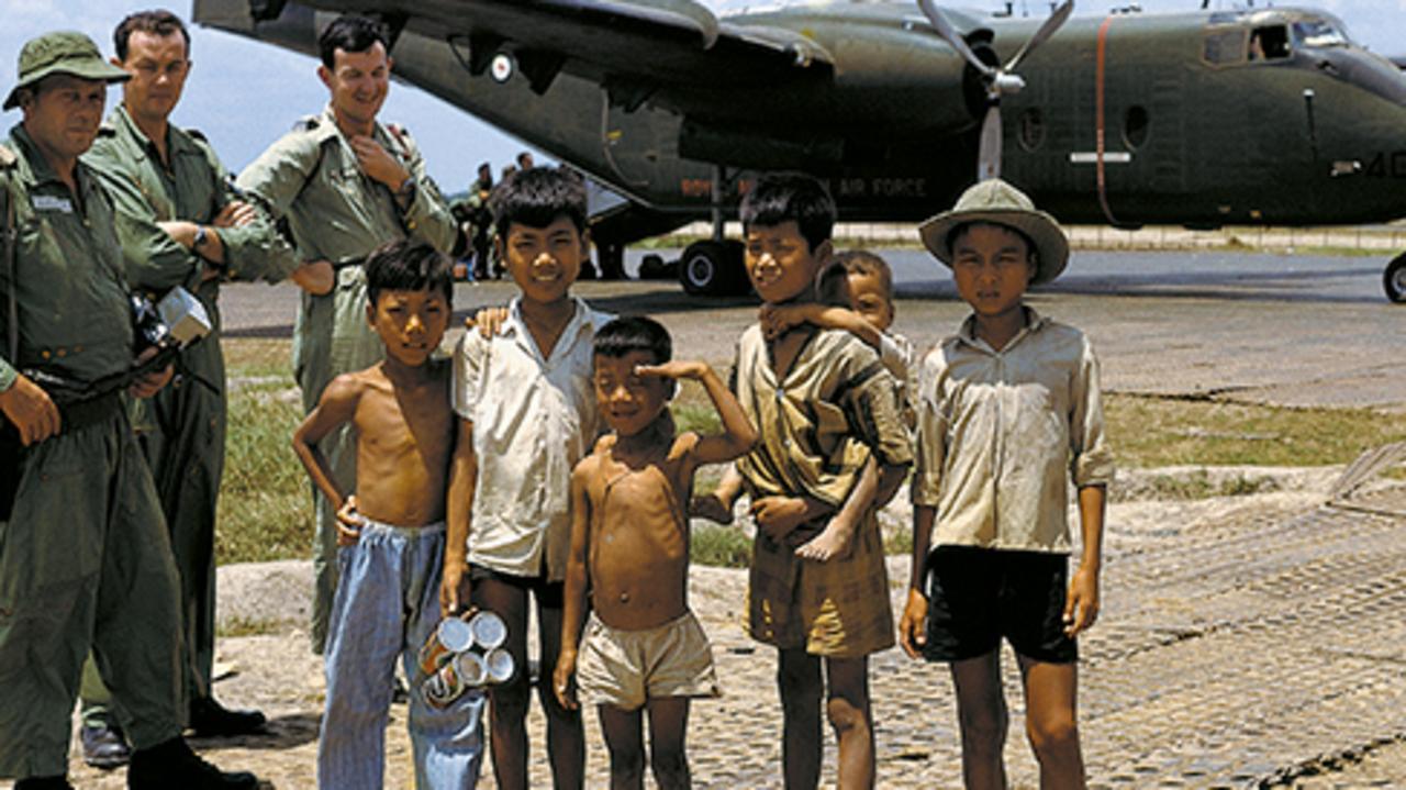 Vietnamese children with Australian soldiers.