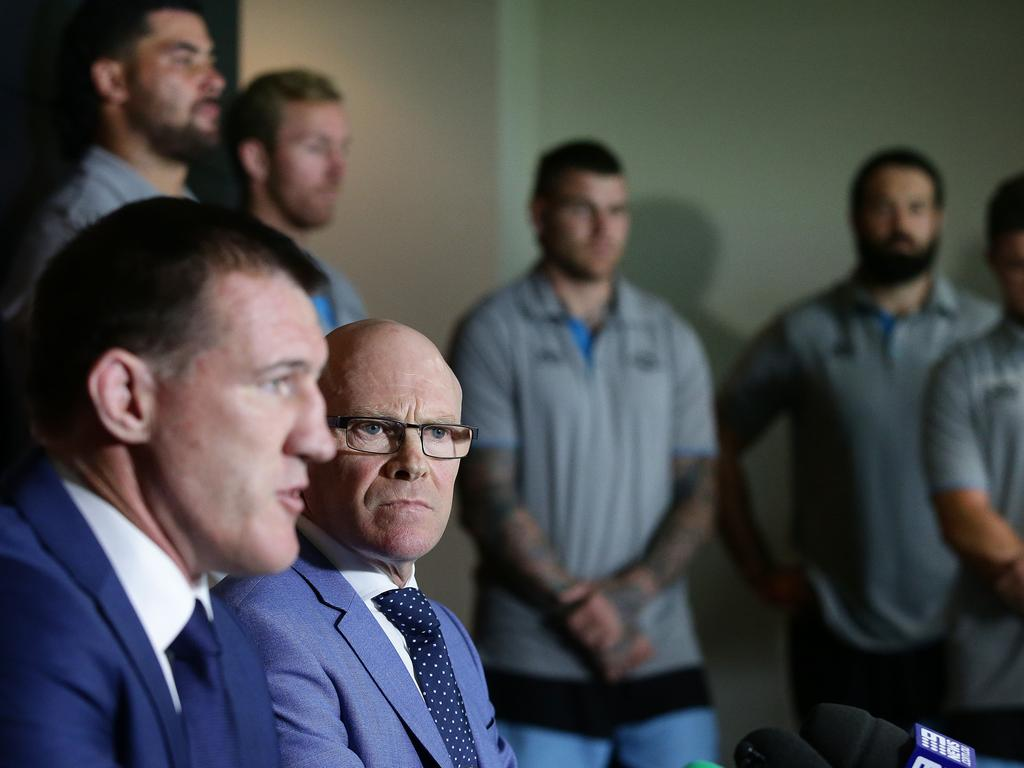 Sharks captain and Sharks CEO Barry Russell surrounded by senior players in a show of support after Flanagan was deregistered by the NRL. Picture: Brett Costello