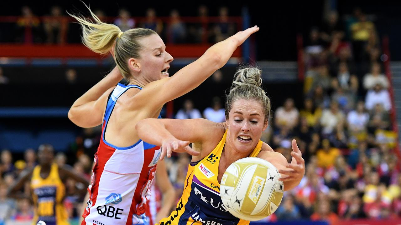 Laura Scherian of the Lightning (right) competes with Katrina Rore of the Swifts during the Super Netball Grand Final between the Sunshine Coast Lightning and the New South Wales Swifts at the Brisbane Entertainment Centre in Brisbane, Sunday, September 15, 2019. (AAP Image/Dave Hunt)