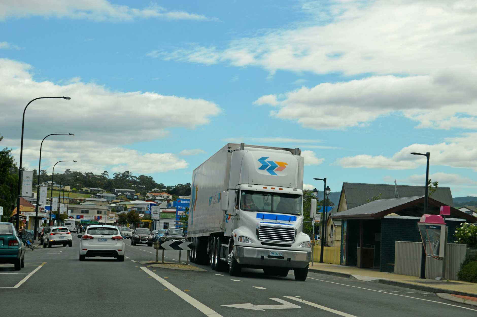 A truck travels through Sorell town after driving across the causeways.