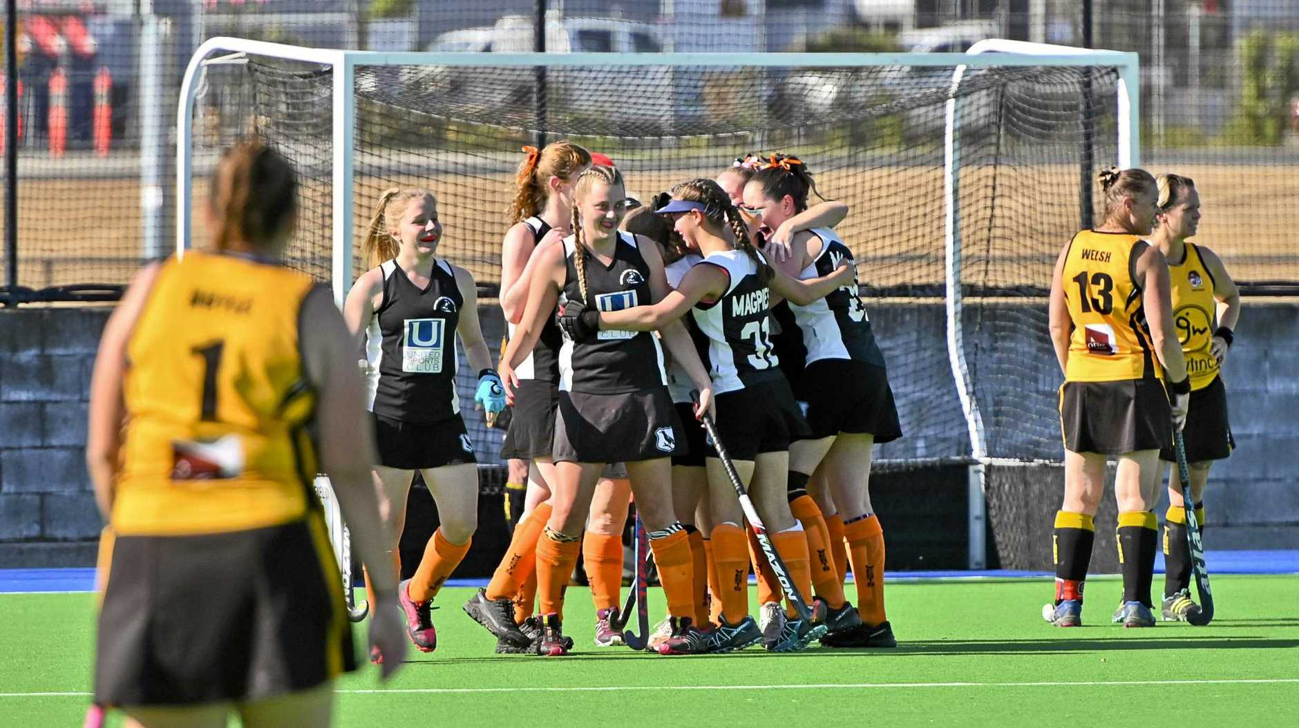 Wests White players celebrate their extra-time Reserve Grade hockey win over Easts in Saturday's grand final.