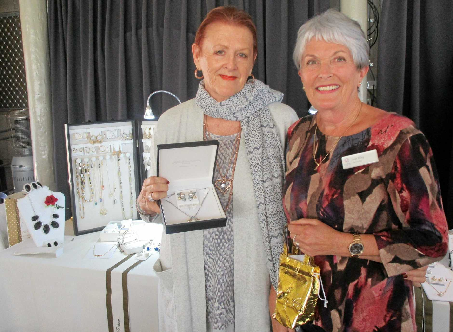 Bev Jackson and Ann Riley in front of the Fifth Avenue jewellery display at the Hervey Bay VIEW Club's August meeting.