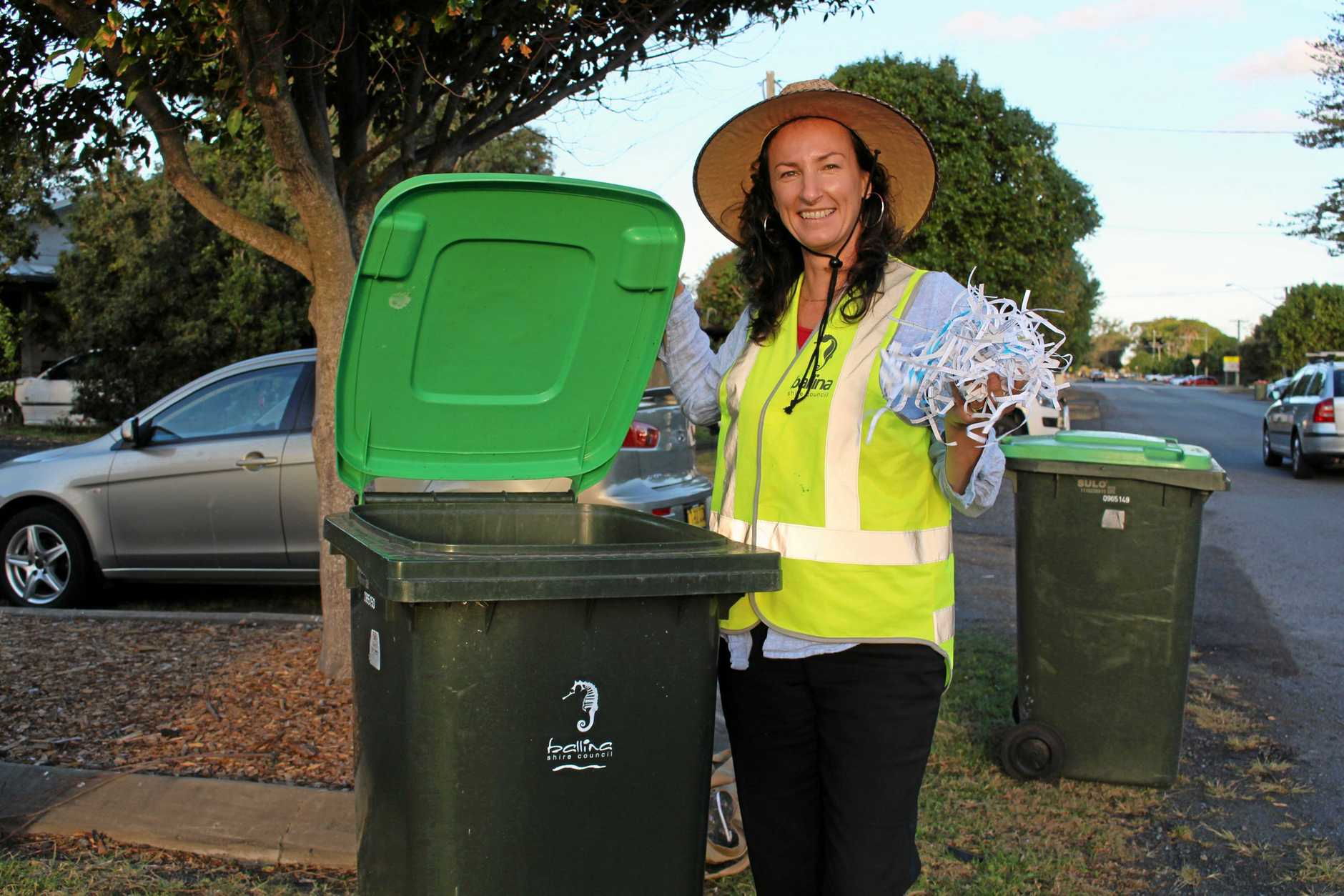 LIFTING THE LID: Ballina Shire Council's Samala Heart checks what's in the organics bin.