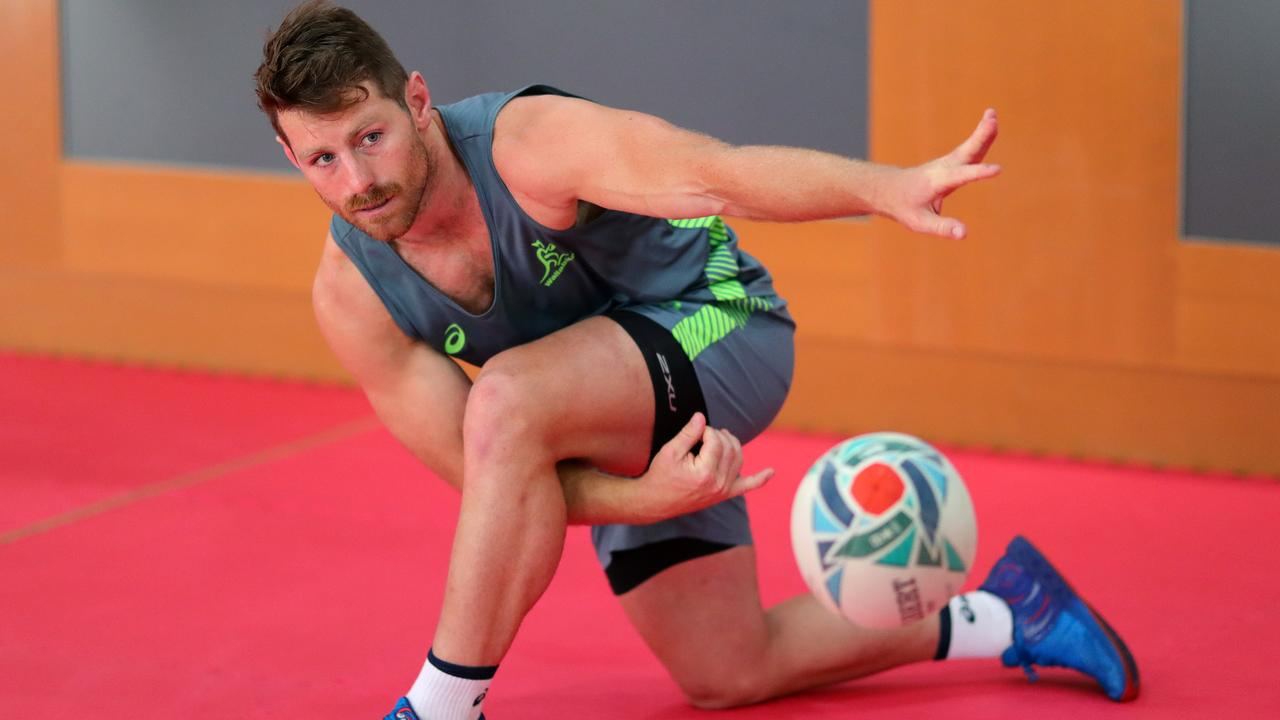 Bernard Foley practices his passing during a gym session. Picture: Getty Images