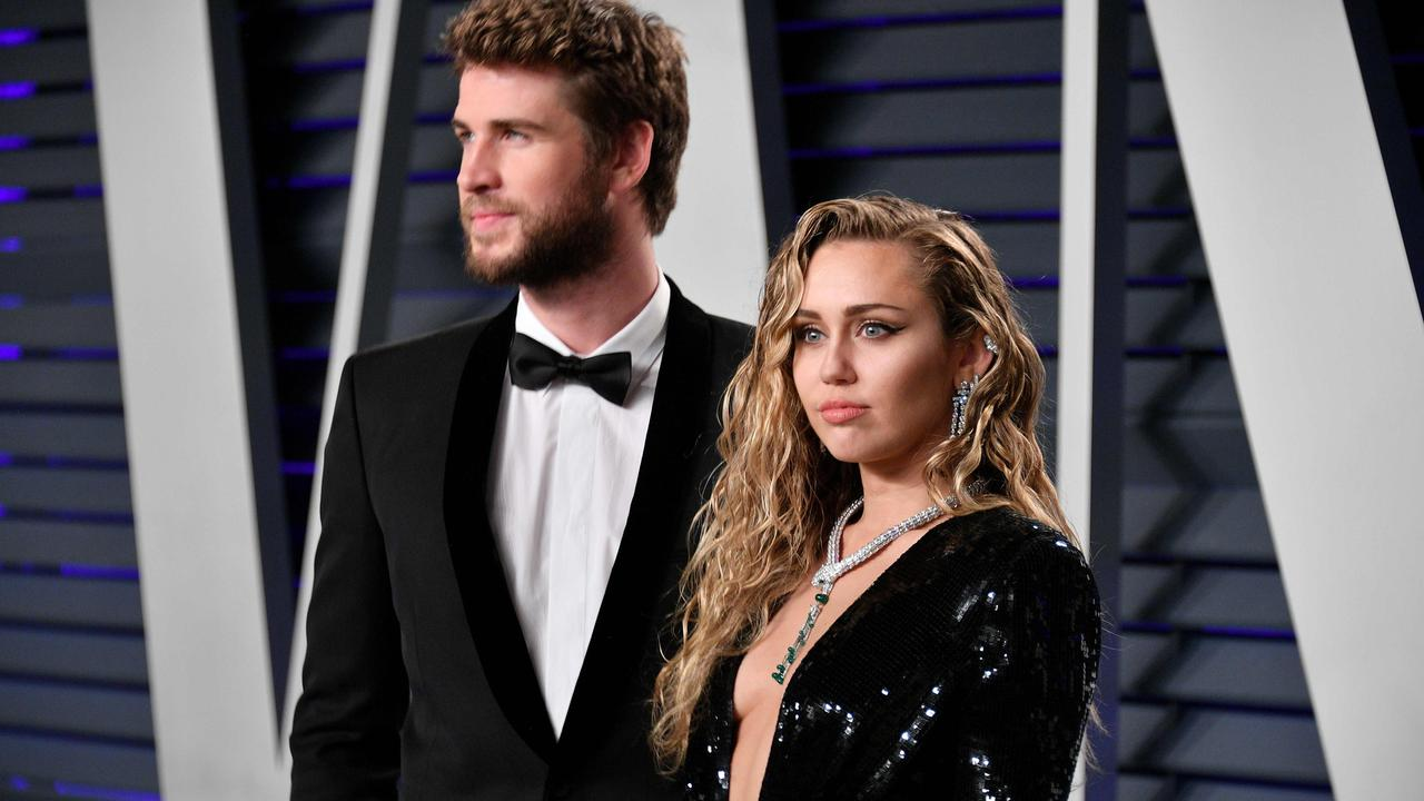 Liam Hemsworth (L) and Miley Cyrus attend the 2019 Vanity Fair Oscar Party hosted by Radhika Jones. Picture: Getty Images.