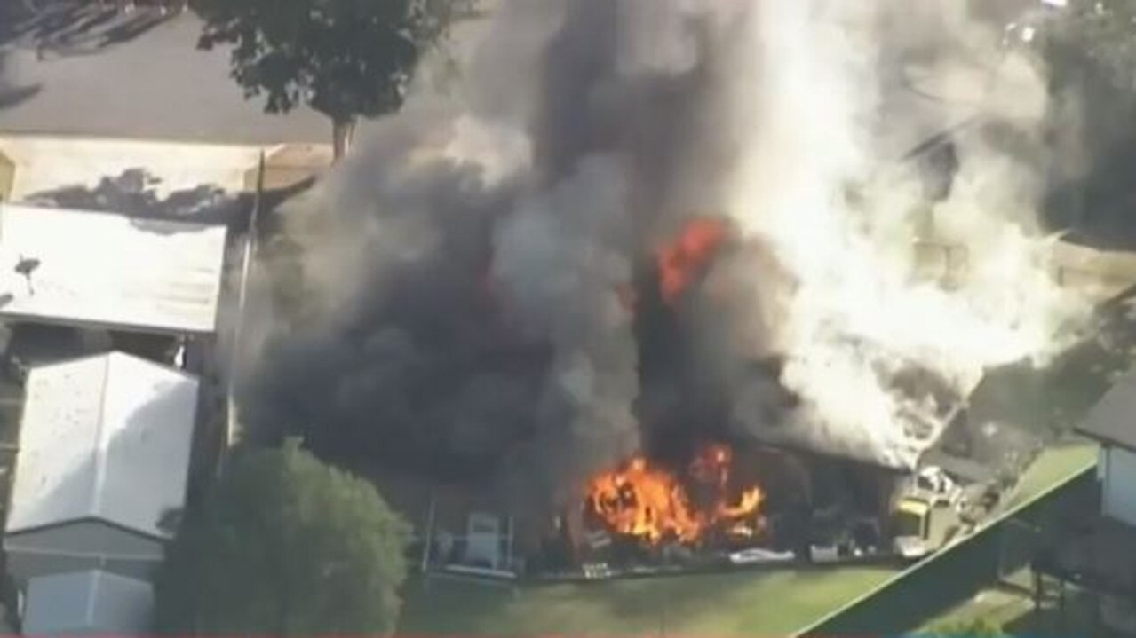 Firefighters are battling a major house fire in Petrie. Picture: 9 News