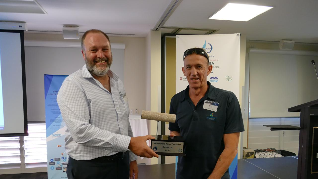 Michael Dalton, Water Quality Officer, Water & Waste Operations, Livingstone Shire Council receiving the trophy from qldwater CEO Dave Cameron.
