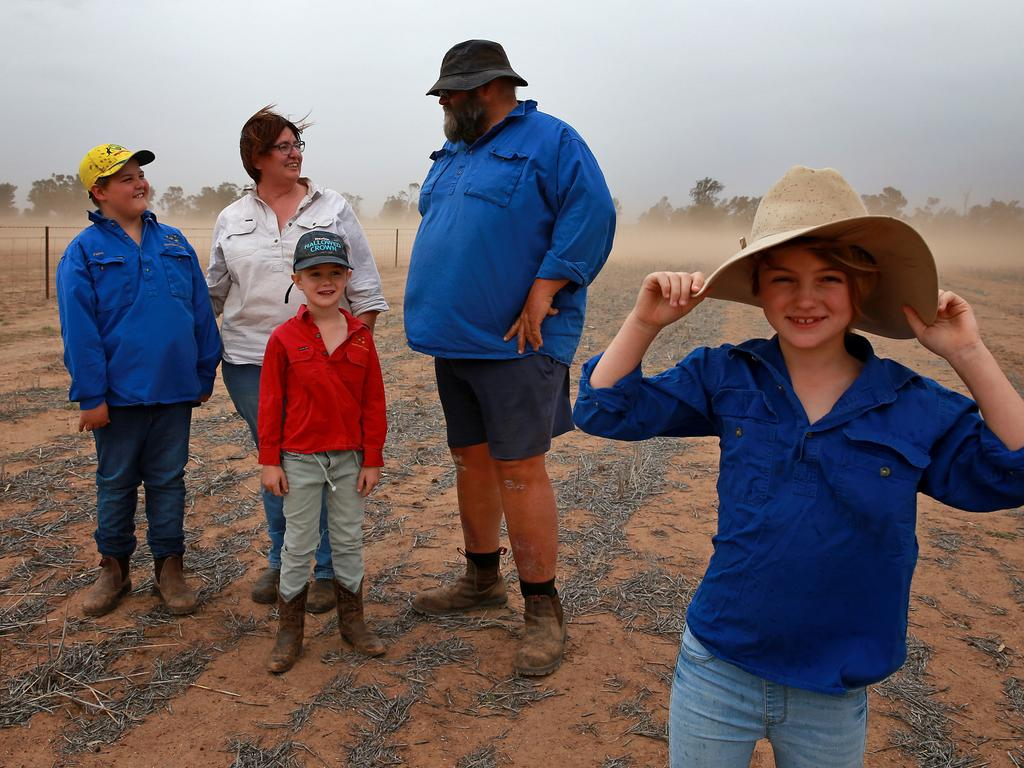 Bill and Fiona Aveyard with kids Archie 9, Evie, 7, and Jim, 6, on their farm outside Narromine in the central west of NSW. Picture: Toby Zerna