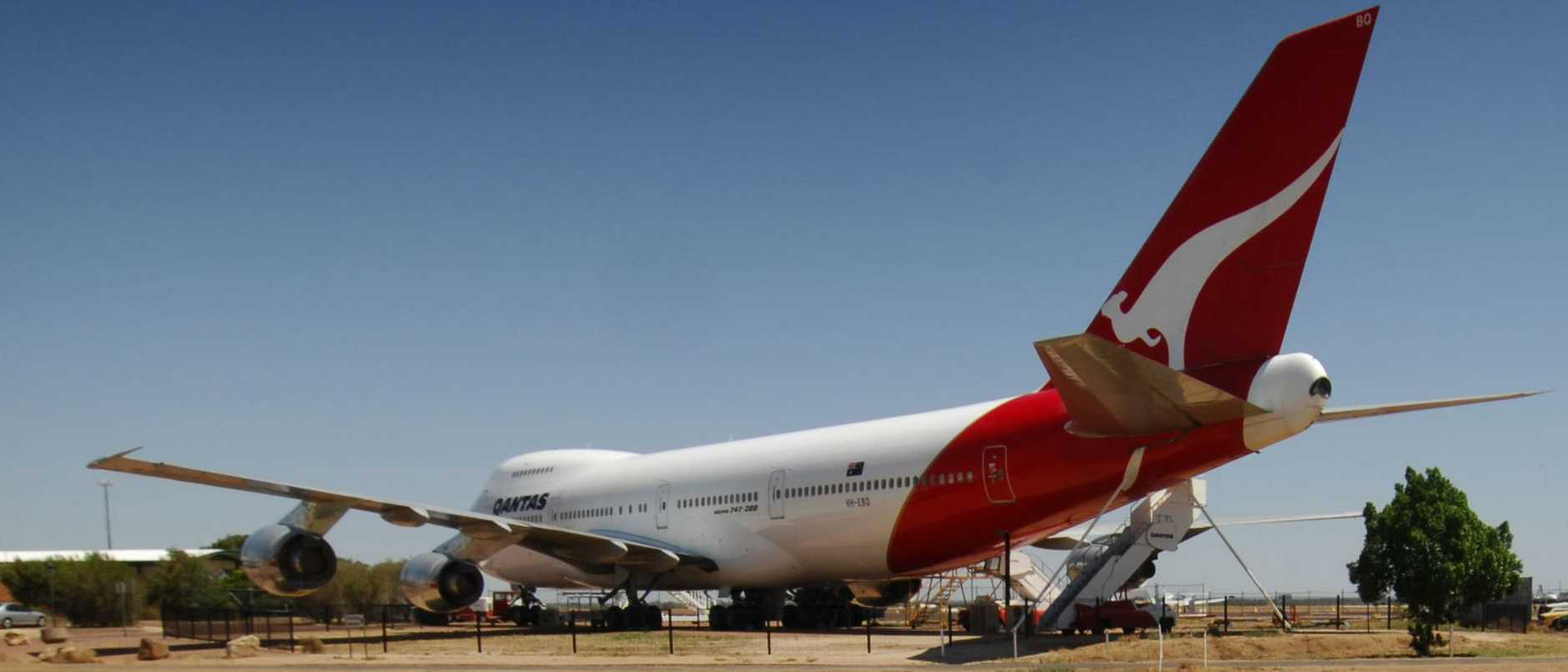 Prominent local Longreach business man Roly Gooding , rarely travels by Qantas as the local fares are too expensive,  prefers bus, under the 747 at the Qantas museum , at the airlines birth place,  at Longreach airport.