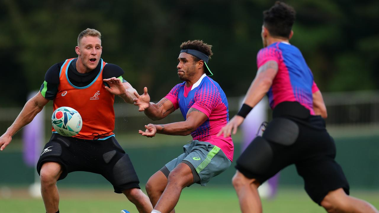 Will Genia passes during training in Odawara. Picture: Getty Images