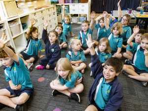 Kindergarten students answer a question in class at