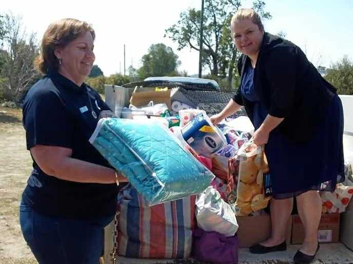 HELP ARRIVES: Oakey QCWA ladies Wendy Gordon and Kara Grant deliver a trailer load of necessities to Purple Dove for fire and drought victims.