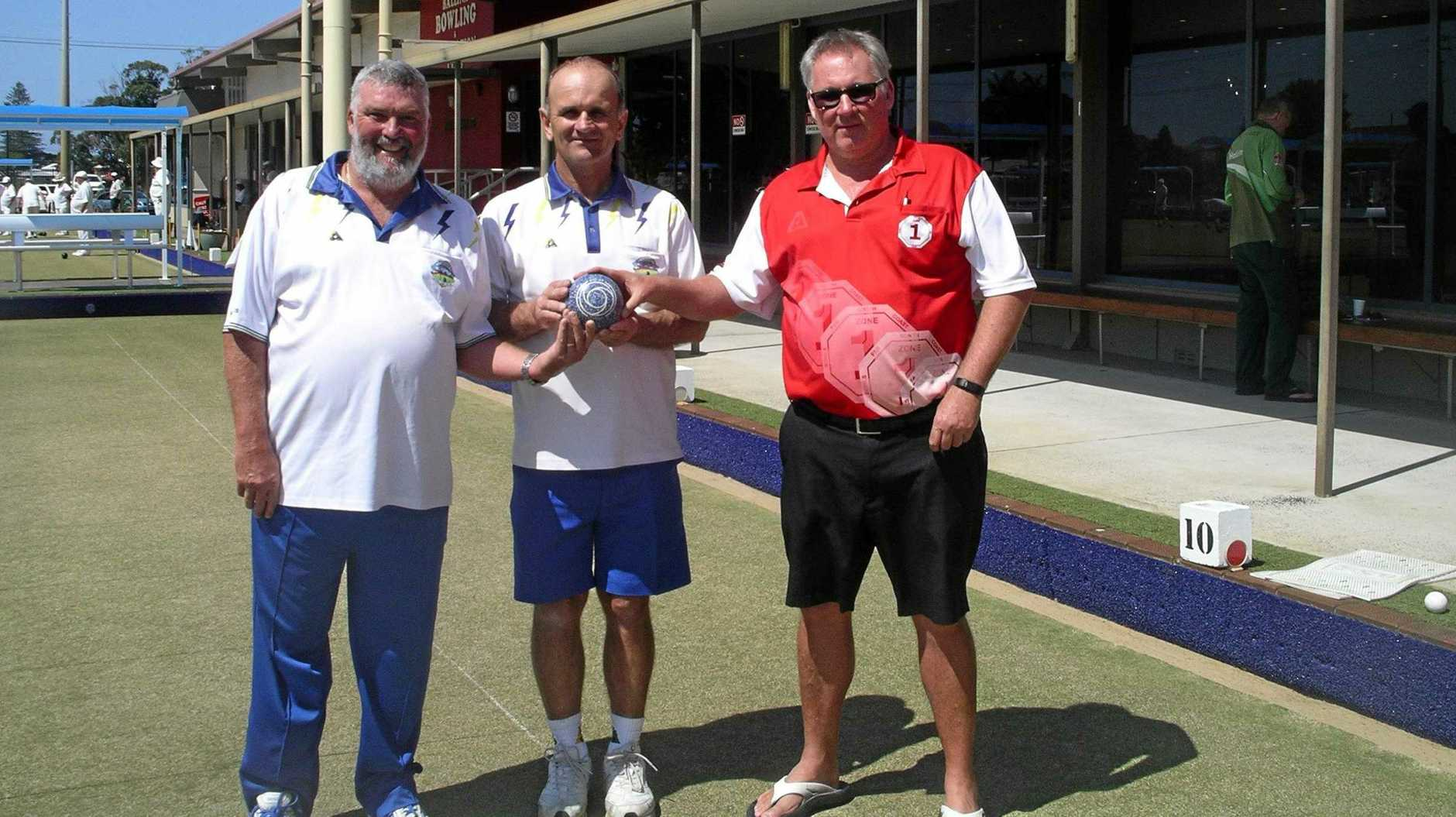 DOUBLE TROUBLE: Lismore Heights bowlers Steve Clarke and Warren Rixon, won the Group State Over 40's Pairs. They are congratulated by Zone One president Kris Lehfeldt.