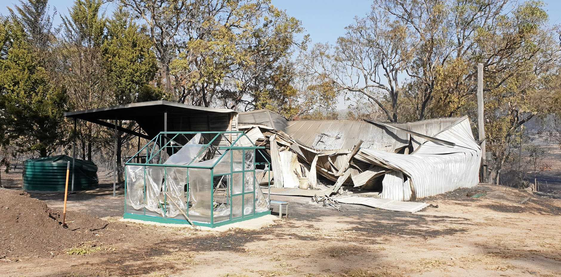 CASUALTIES: Tony and Bron Southgate lost several structures on their property. The worst loss was Mr Southgate's art collection.