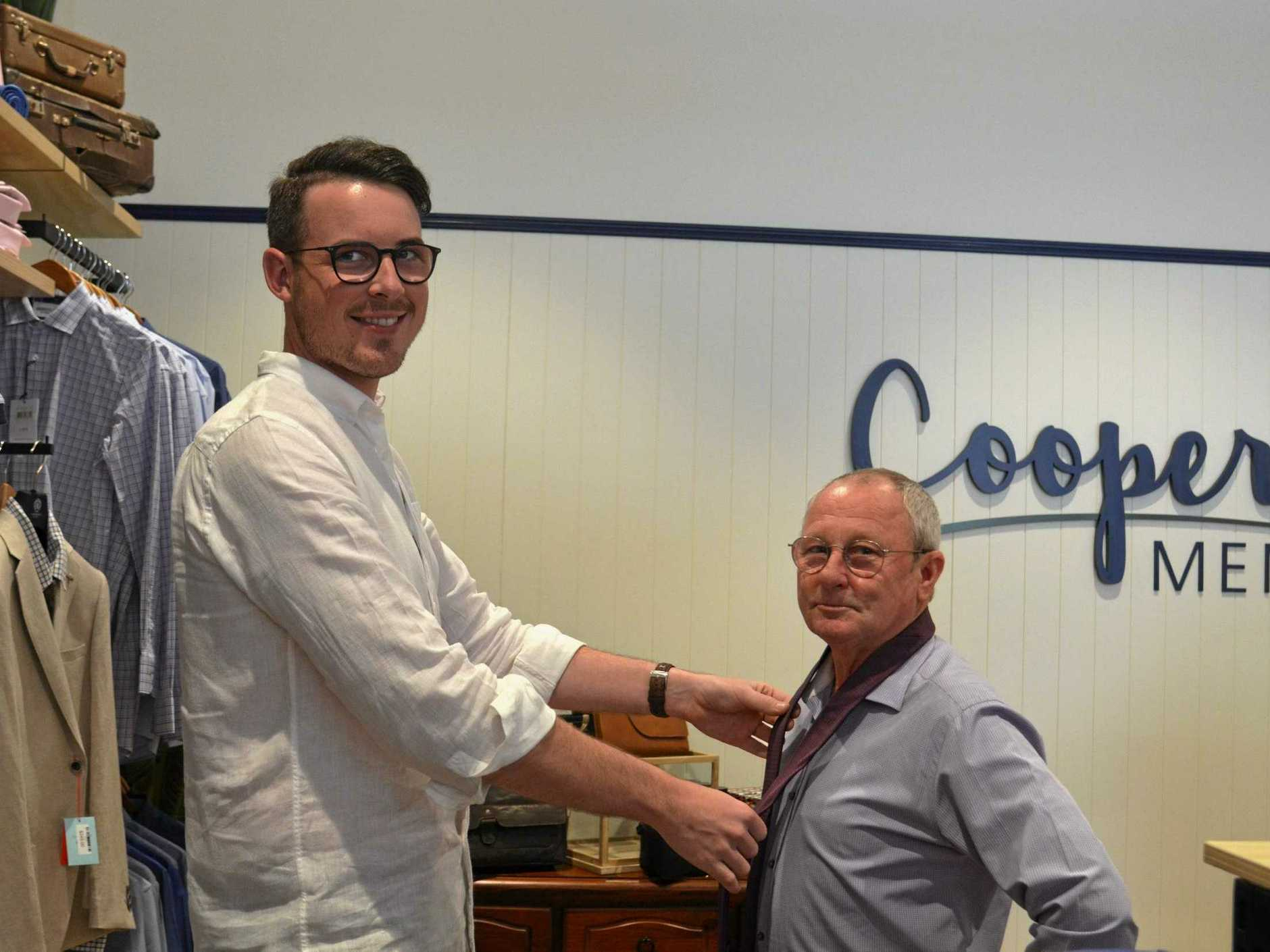 NEW SHIRT DOES WONDERS: Store owner Andrew Cooper shows Graham Lowrie what dressing up can do for self-esteem.