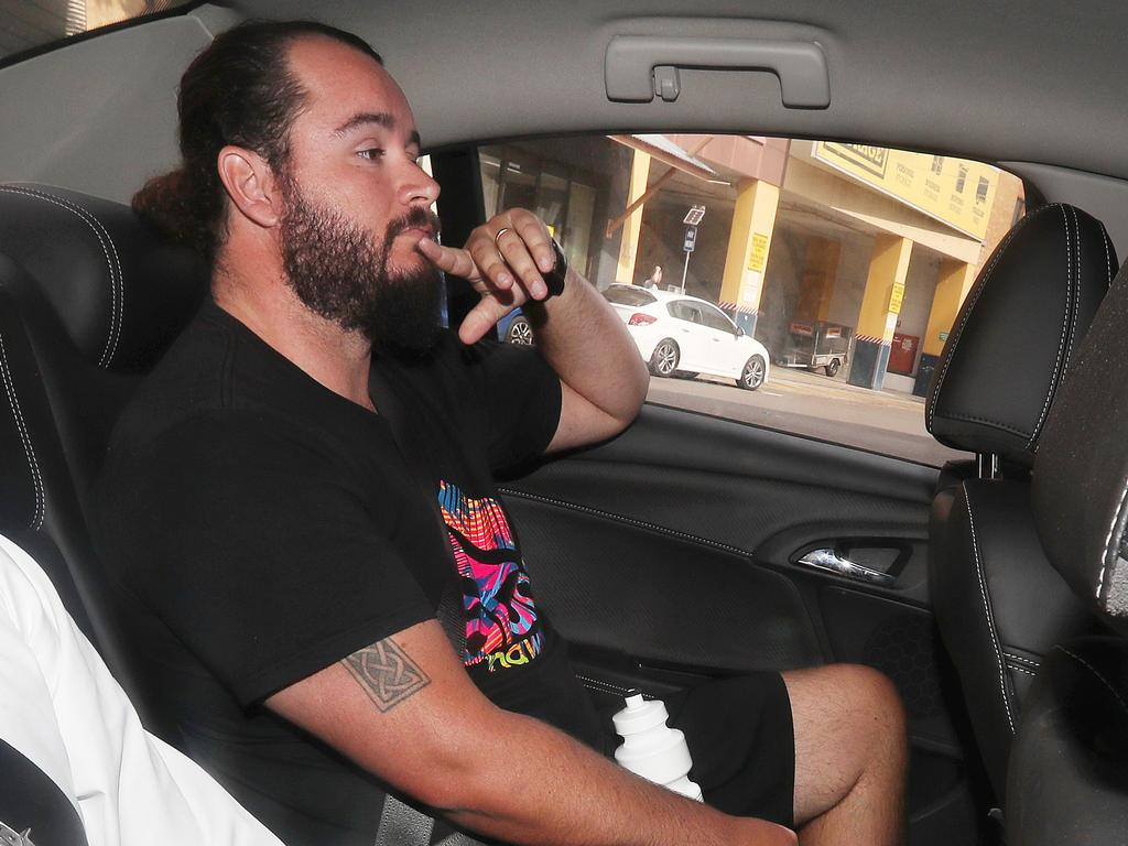 Former Kimberley College principal Paul Thompson's son-in-law Kevin Ferguson being driven into the Brisbane watch house by police. Photographer: Liam Kidston.