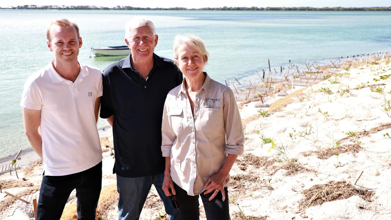 NEW LIFE: Brady Sullivan, Paul Harney and Susie Chapman are excited to see the benefits of the soft engineering on the shoreline erosion at Pumicestone Passage in Golden Beach. Photo: Lacee Froeschl